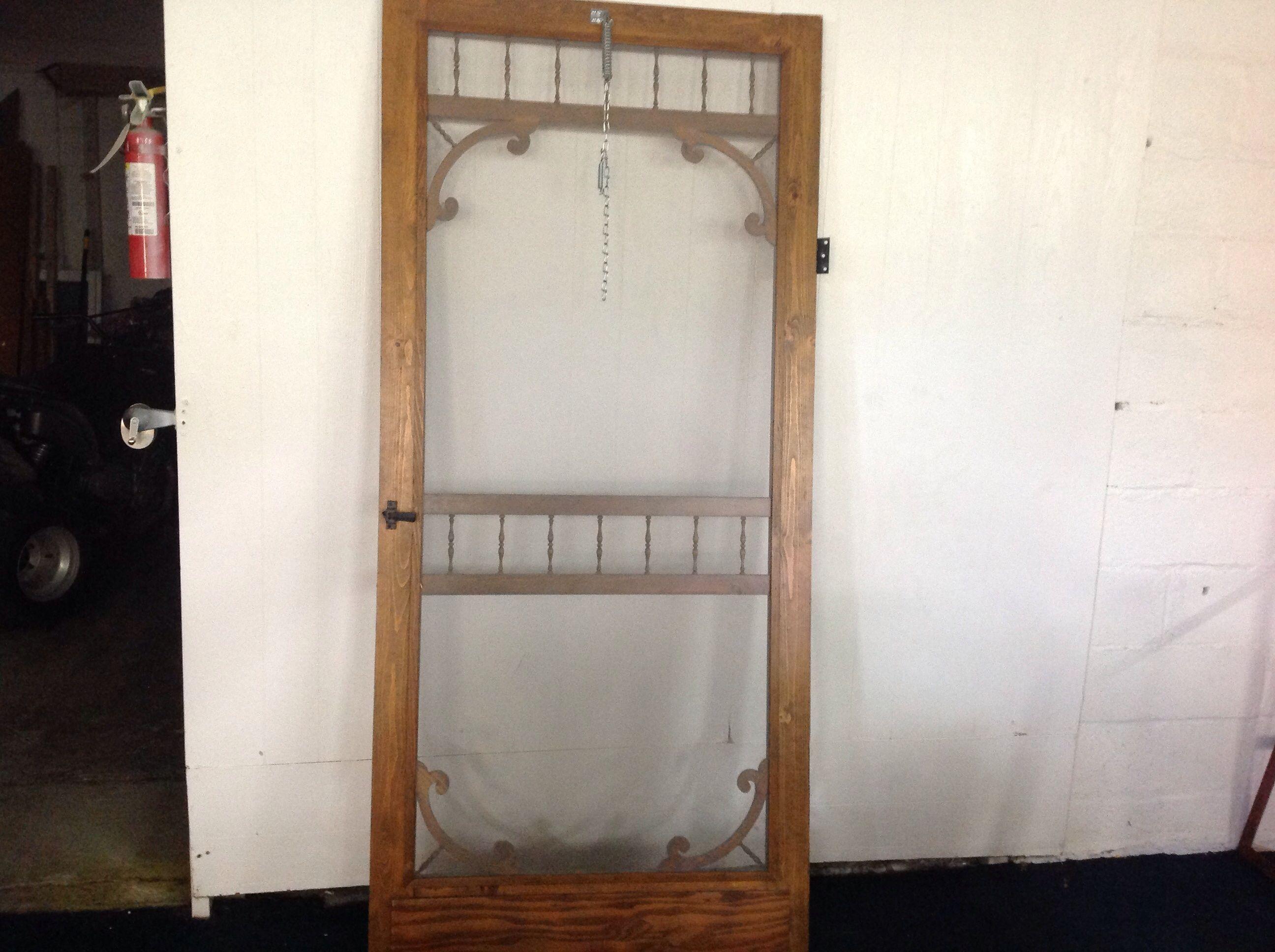 Lot detail wooden screen door with hardware