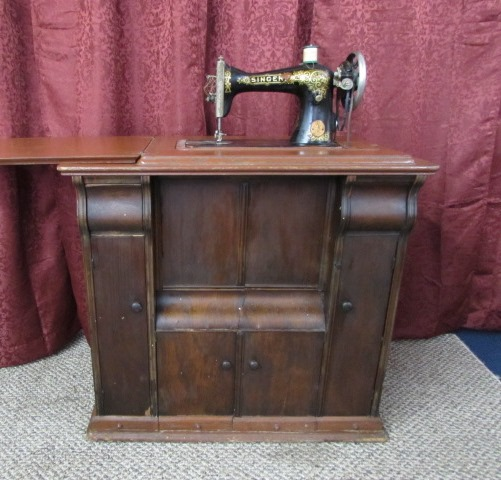 DOUBLE RARE ANTIQUE SINGER TREADLE SEWING MACHINE IN PARLOR CABINET ... - Lot Detail - DOUBLE RARE ANTIQUE SINGER TREADLE SEWING MACHINE IN