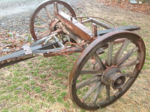 Lot Detail - ANTIQUE WOODEN WAGON WHEEL PAIR WITH AXLE
