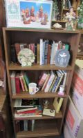 BOOKSHELF WITH A WIDE RANGE OF THEOLOGY BOOKS, BIBLES & MORE
