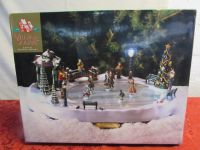 HOLIDAY VILLAGE SQUARE MUSICAL ICE RINK WITH SKATERS.  PLAYS 50 SONGS!