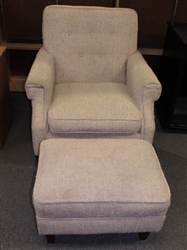 KICK UP YOUR FEET AFTER A HARD DAYS WORK IN THIS SOFT UPHOLSTERED CHAIR WITH FOOTREST