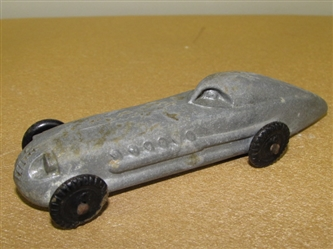 COLLECTIBLE VINTAGE CAST ALUMINUM TOY RACECAR WITH SOLID WHEELS