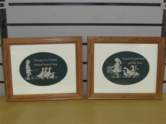 A PAIR OF NICELY DONE FRAMED CROSS STITCH WALL HANGINGS ON FRIENDSHIP & LOVE