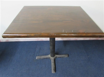 LACQUER TOP WOOD TABLE WITH HEAVY IRON BASE
