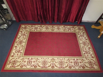 BEAUTIFUL AREA RUG IN GREAT CONDITION