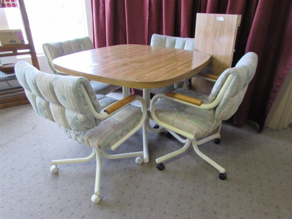 kitchen table comes with center leaf and 4 rolling upholstered chairs
