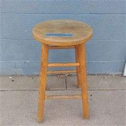 A SMALL WOOD STOOL