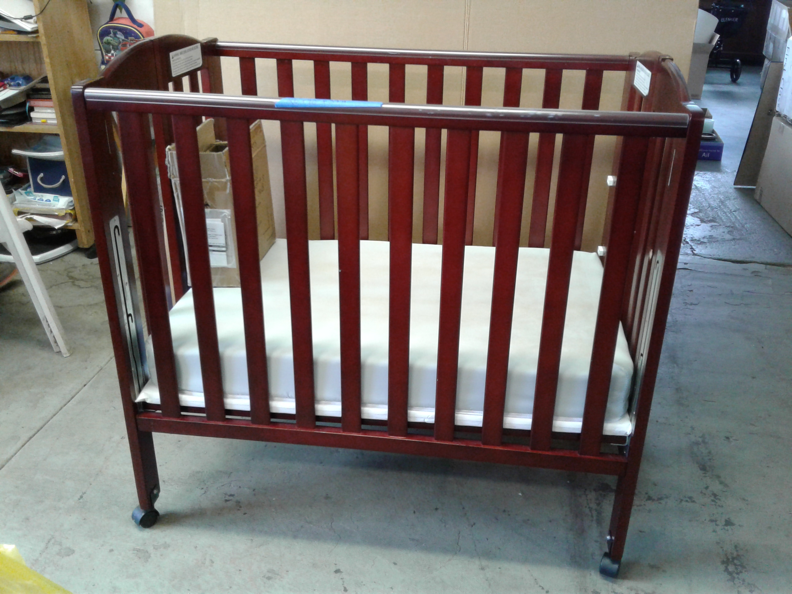 Lot Detail - Portable Crib, Mattress, and Sheets