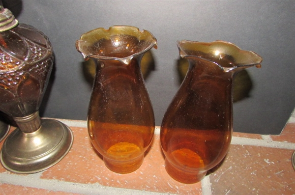 PAIR OF VINTAGE AMBER GLASS HURRICANE OIL LAMPS
