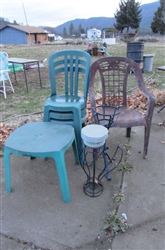 GREEN PLASTIC BISTRO CHAIRS AND TABLE WITH PLANT STANDS