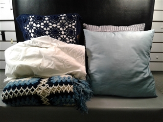 13 Pillows And A Blue Blanket